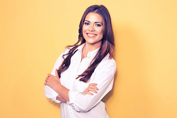 smiling business woman portrait with crossed arms.  white shirt