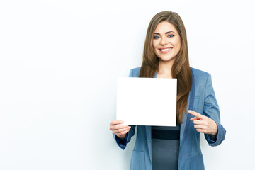 Finger pointing. Smiling business woman hold white card.