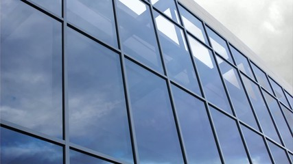 Glass facade with reflection of clouds
