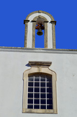 Querenca church window and bell tower