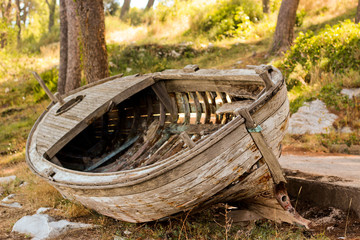 Leaky old boat on the shore