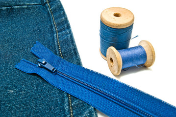 denim with zipper and spools of thread