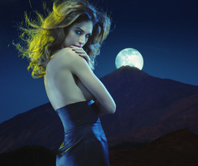 Seductive young lady at moonlight