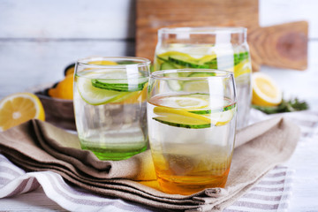 Fresh water with lemon and cucumber in glassware