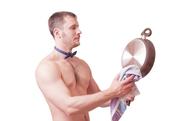 Attractive man with a towel wipes clean pan