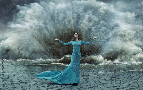 Alluring, elegant woman over the sand&water storm - 80630540