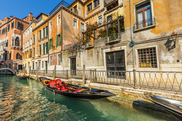 Lovely canal with gondola in Venice
