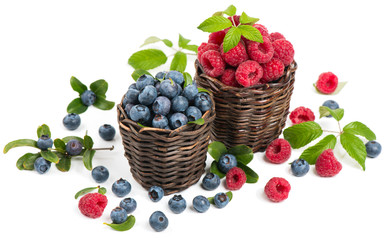 Small baskets with fresh blueberries and raspberries