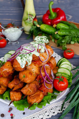 Chicken kebab with tomatoes