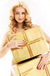 Delicate nude lady holding huge boxes of presents
