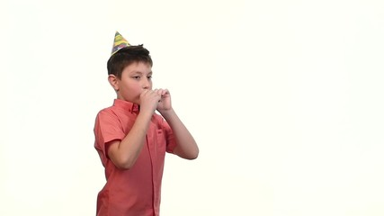 boy in birthday cap inflates a purple ball