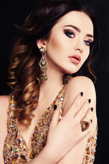 beautiful woman with dark hair and bright makeup, with bijou