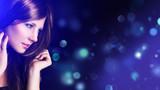 Fototapety attraktive junge Frau vor Bokeh-Hintergrund
