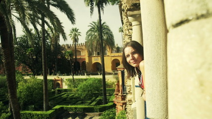 pretty woman looking at view from terrace in  Alcazar garden