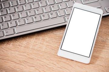 Smartphone laying on laptop keyboard
