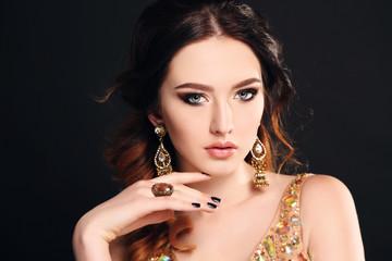 woman  wearing luxurious sequin dress and bijou