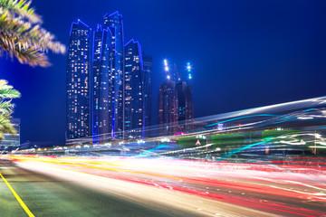 Traffic lights on the street of Abu Dhabi at night, UAE