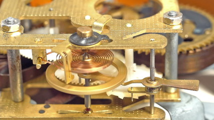 Mechanical clock mechanism in action. Three clips in one.