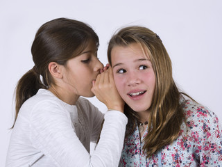 Two friends talking to the ear