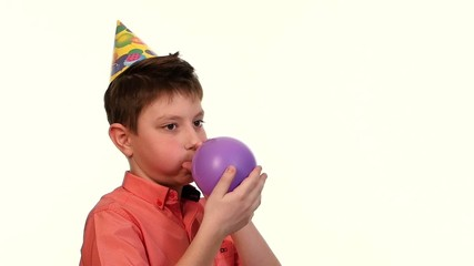 The boy in the red shirt inflates a balloon purple, slow motion