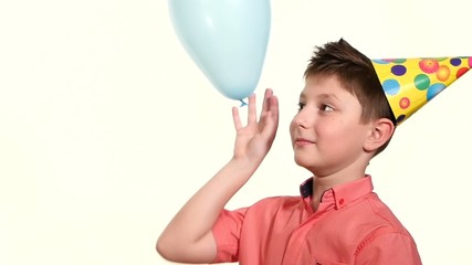 Boys playing with balloon blue, he throws his female hand, slow