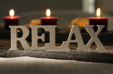Sign of the word relax with candles