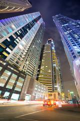 Traffic lights on the street of Dubai at night, UAE