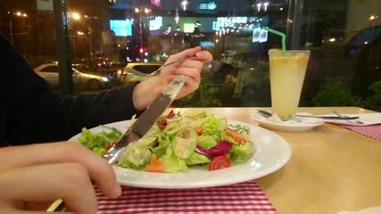 Guy enjoying appetizing salad, eating out, having low-fat dinner