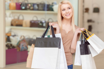 Girl holds shopping bags in her hands