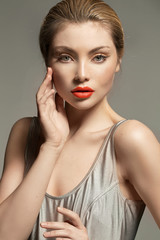 Portrait of an adorable young lady with beautiful red lips