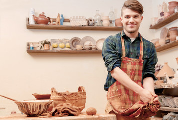 Potter washes his hands in clay studio