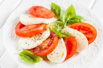 Caprese.Italian salad  with mozzarella, tomato and basil