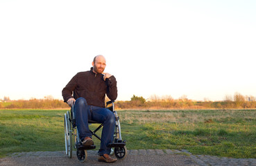 man in a wheelchair reflecting upon life.