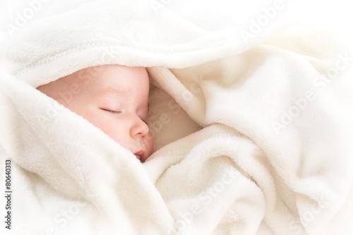 Fototapeta Baby sleeping covered with soft blanket