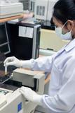 Woman test blood on biochemistry automate poster
