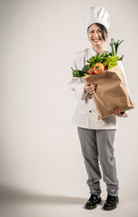 Happy Chef Holding Paper Bag with Fresh Vegetables