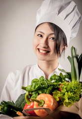 Happy Female Chef with Healthy Farm Vegetables