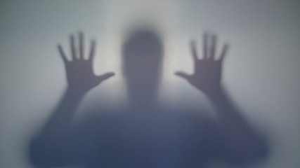 Mysterious silhouette frightens with sharp moves, supernatural