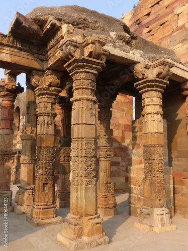Aluminium Delhi Columns with stone carving in courtyard of Quwwat-Ul-Islam mosqu