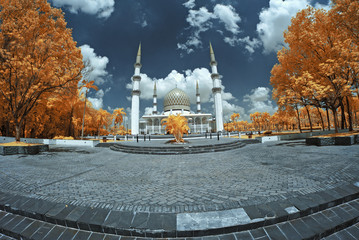 Beautiful Shah Alam mosque by the garden viewed in infrared