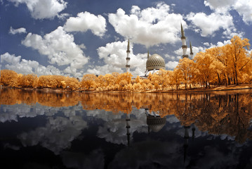 Beautiful Shah Alam mosque by the lakeside viewed in infrared