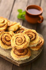 Homemade cinnamon rolls on wooden board