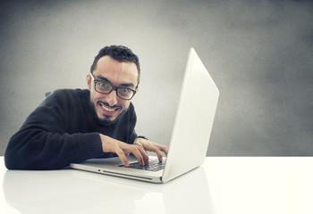 Hacker working on laptop.