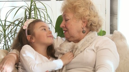 Little girl and her grandmother indoors