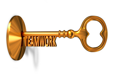 Teamwork - Golden Key is Inserted into the Keyhole.