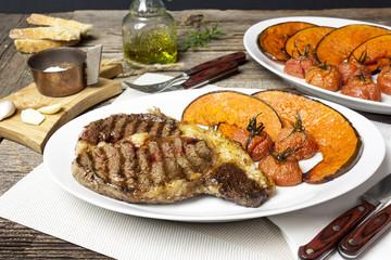 Ribeye steak with baked pumpkin