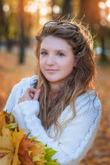 Brunette walks in autumn park