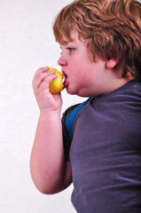 portrait of schoolchild eating apple