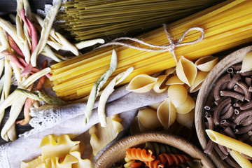 Different types of pasta on napkin, macro view