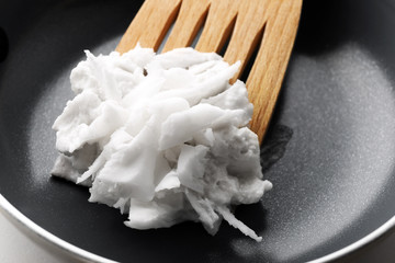 Coconut oil in frying pan close up